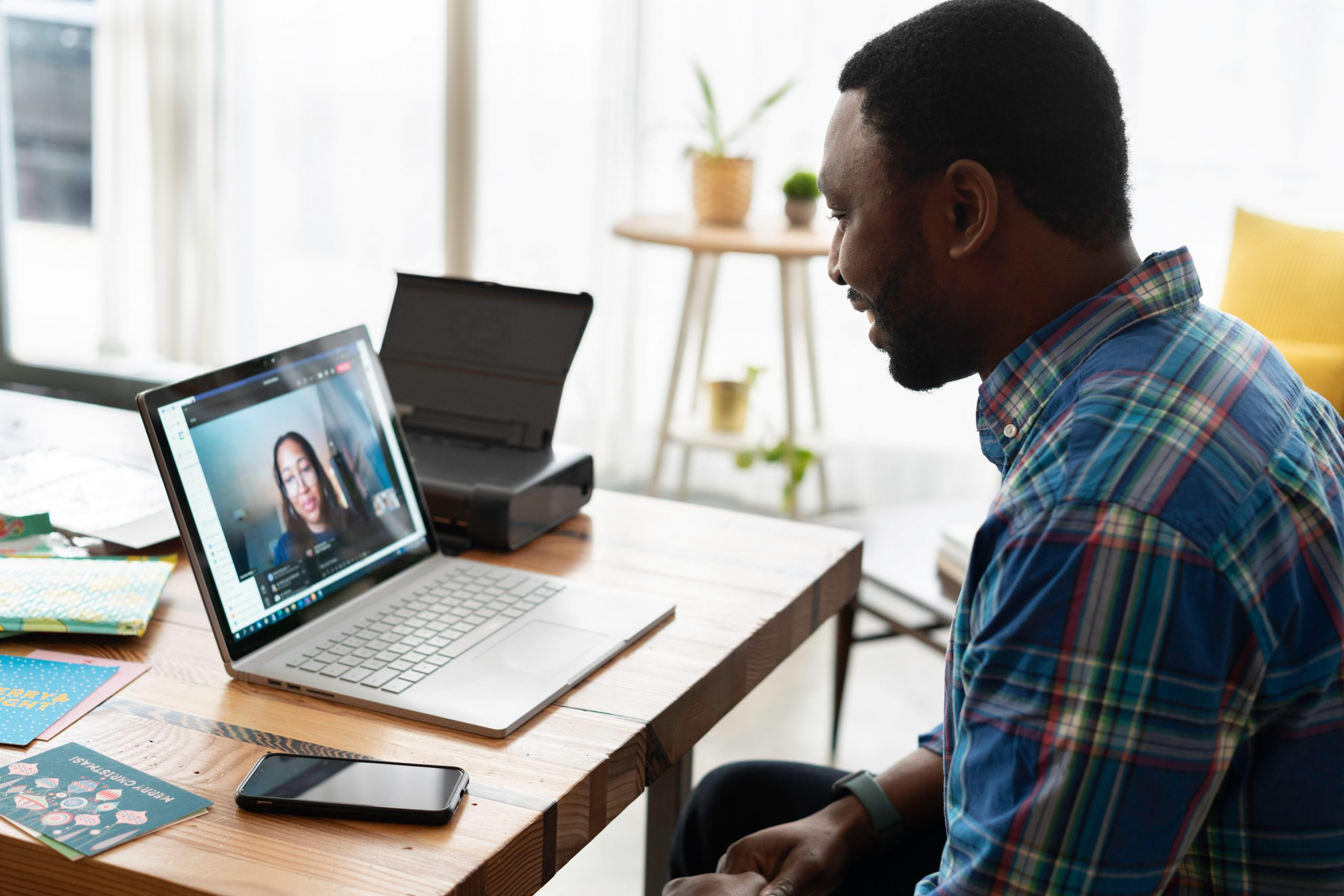 Man holding cross-cultural virtual meeting on Zoom